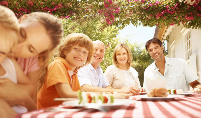Blended family together at table