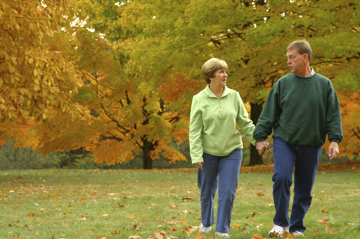 Couple walking and talking while holding hands