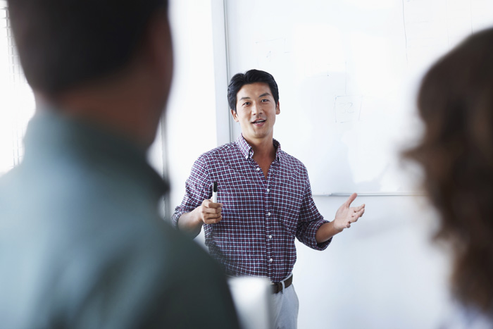 Man presenting in a business meeting